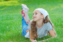 Girl in a city park Royalty Free Stock Image
