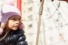 Girl in the city playground Royalty Free Stock Photography