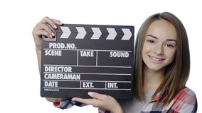 Girl with clapperboard winking stock video footage
