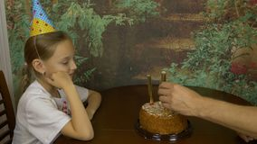 Girl clapping by hands. Sitting girl afraid of fire. Sparkling fire fountains in a cake. Girls Birthday. Cake with. Girl clapping by hands. Sitting girl afraid stock video