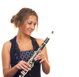Girl with clarinet. Beautiful girl in black dress isolated on white background holding clarinet Stock Photography