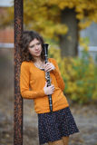 The girl with the clarinet. In his hands Stock Photos
