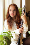 Girl with clarinet Royalty Free Stock Photo