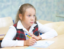 Girl in the class. Children in the class room stock photography