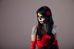 Girl with classic sugar skull makeup. Day of the Dead, Halloween royalty free stock images