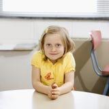 Girl in Classroom. Stock Photos