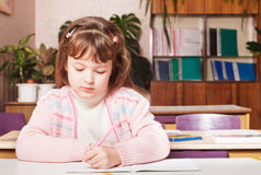Girl in classroom Stock Image