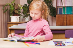 Girl in classroom Royalty Free Stock Images