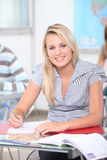 Girl in classroom Stock Images