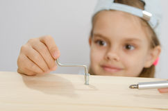 Girl in the classroom working spins screw Stock Images