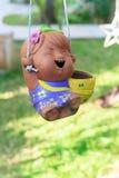 Girl Clay doll for garden decoration Stock Photos