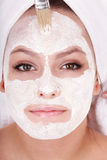 Girl with clay facial mask. Stock Photo