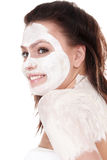 Girl with clay facial mask. Royalty Free Stock Photography