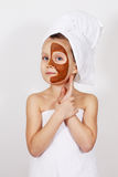 Girl with a clay mask Stock Photo
