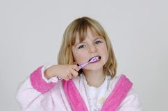 Girl clean her teeth Stock Photos