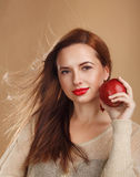 Girl with clean skin holding an apple. Royalty Free Stock Photography