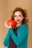 Girl with a clean skin holding a pumpkin. Stock Image