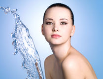 Girl with clean skin and stream of water Stock Photography