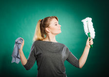 Girl with cleaning cloth in hand. Stock Photography