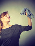 Girl with cleaning cloth in hand. Royalty Free Stock Photo