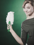 Girl with cleaning cloth in hand. Stock Image
