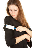 Girl cleaning dust with lint roller. Young woman cleaning dust with lint roller Stock Photos