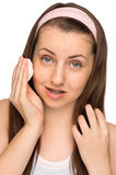 Girl cleaning face with cotton pad isolated Royalty Free Stock Image