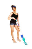 Girl cleaning floor. Stock Image