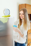 Girl cleaning  glass door Royalty Free Stock Photography