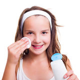 Girl cleaning her face with tonic lotion Royalty Free Stock Images