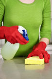 Girl cleaning kitchen Stock Photo