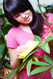 Girl cleaning leaf Stock Images