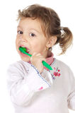 Girl cleaning the teeth stock photo
