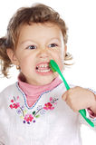 Girl cleaning the teeth Stock Photos