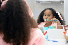 Girl cleaning teeth Stock Photos