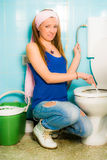 Girl cleaning toilet seat stock images