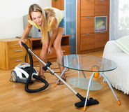 Girl cleaning with vacuum cleaner Royalty Free Stock Photo