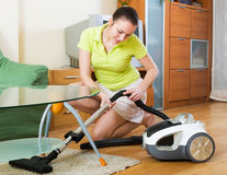Girl cleaning with vacuum cleaner Royalty Free Stock Photos