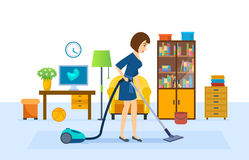 Girl is cleaning, vacuuming in the room, putting in order Royalty Free Stock Image