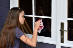 Girl cleaning windows royalty free stock photo