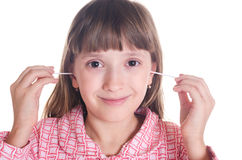 The girl cleans ears. The girl in a pajamas cleans ears hygienic sticks stock photography
