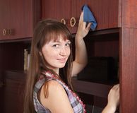 Girl cleans furniture indoor Stock Photography