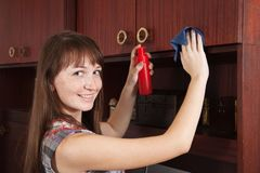 Girl cleans a furniture indoor Stock Image