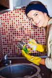Girl cleans a glass Royalty Free Stock Photo