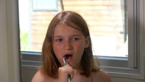 Girl cleans his teeth. Little girl brushes his teeth in the bathroom stock video footage