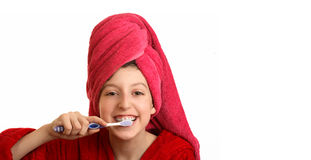 The girl cleans a teeth. The girl in a red dressing gown cleans a teeth Stock Image