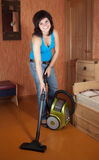 Girl cleans with vacuum cleaner Royalty Free Stock Photo