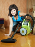 Girl cleans with vacuum cleaner Royalty Free Stock Photography