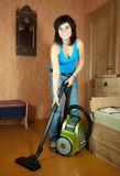 Girl cleans with vacuum cleaner Royalty Free Stock Images