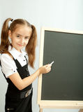 Girl and clear blackboard Royalty Free Stock Image